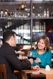 Couple toasting at dinner Stock Photography