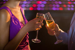 Couple toasting glass of champagne in bar Stock Photo