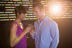 Couple toasting glass of champagne in bar Royalty Free Stock Image