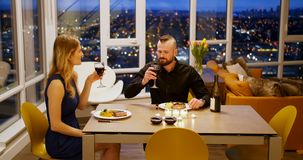 Couple toasting glass of wine while having dinner 4k. Couple toasting glass of wine while having dinner at home 4k stock video