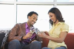 Couple toasting glasses. Stock Photo