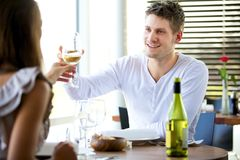 Couple Toasting Glasses of Wine Stock Image