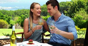 Couple toasting glasses of wine in outdoor restaurant 4k stock video