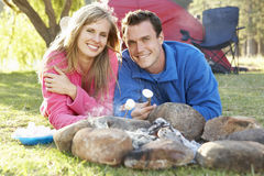 Couple Toasting Marshmallows Over Fire Camping Holiday Royalty Free Stock Photos