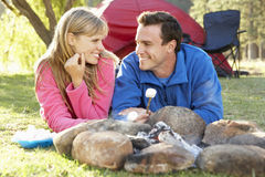 Couple Toasting Marshmallows Over Fire Camping Holiday Royalty Free Stock Images