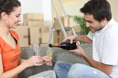 Couple toasting the new house Stock Photography