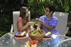 Couple toasting at outdoor lunch Stock Photo
