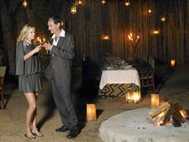 Couple Toasting At Outdoor Nightclub Stock Photography