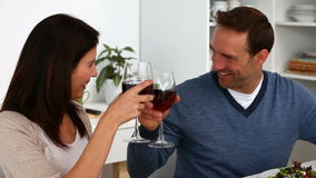 Couple toasting with red wine during the lunch Stock Photo