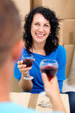 Couple toasting with red wine in the new house Royalty Free Stock Photos