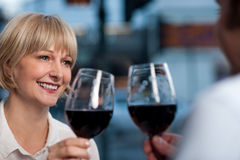 Couple toasting in a restaurant Stock Image