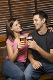 Couple Toasting Their Beers Royalty Free Stock Photos