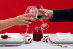 Couple toasting their glasses Royalty Free Stock Images