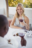 Couple toasting their wine glasses Stock Images