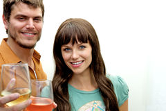 Couple toasting toward camera Stock Photography