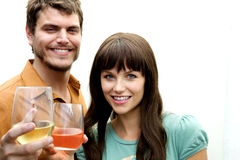 Couple toasting toward camera Royalty Free Stock Photo