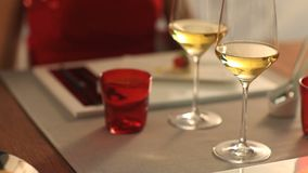 Couple toasting with wine at restaurant stock video