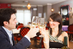 Couple toasting wineglasses Royalty Free Stock Photo
