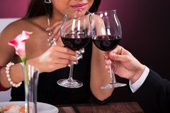 Couple toasting wineglasses in restaurant Royalty Free Stock Photography