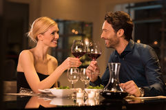 Couple toasting wineglasses Royalty Free Stock Images
