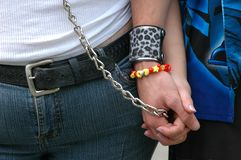 Couple Together. Young adults holding hands Stock Image