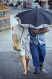 Couple Together. Couple walking in the rain royalty free stock photography