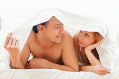 Couple  together in bed Royalty Free Stock Photography