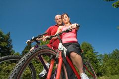 Couple Together on Bikes - horizontal Royalty Free Stock Photo
