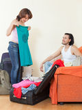 Couple together choosing clothes for vacation Royalty Free Stock Photography