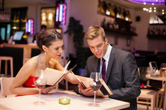 Couple together choosing meal Stock Images