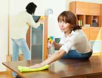 Couple together doing cleanup Stock Images