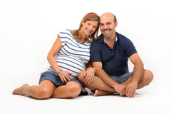 Couple together on the floor Royalty Free Stock Image