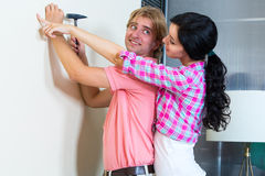 Couple together has small home repairs Stock Image