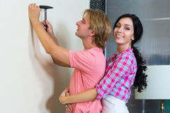 Couple together has small home repairs Stock Images