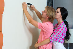 Couple together has small home repairs Stock Photos