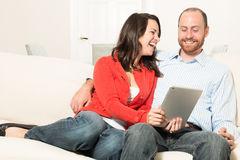 Couple together having fun. In the living room Stock Image