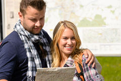 Couple together on holiday with map happy Stock Image