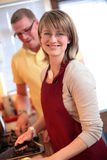 A Couple Together in the Kitchen Royalty Free Stock Photo