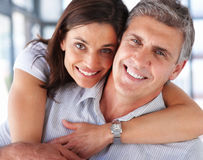 Couple together in the living room Stock Photography