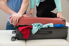 Couple together packing luggage Stock Image