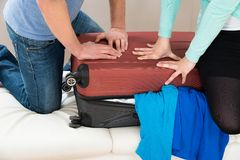 Couple together packing luggage Royalty Free Stock Photo