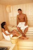 Couple together in sauna. Enjoying relaxation royalty free stock photo