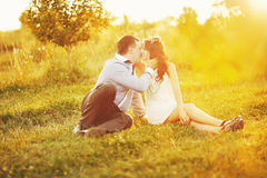 Couple together spending great time in garden Royalty Free Stock Photos