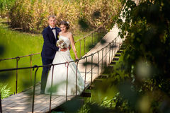Couple together on the suspension bridge Stock Image