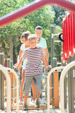 Couple together with teenager overcoming the obstacle course Stock Image