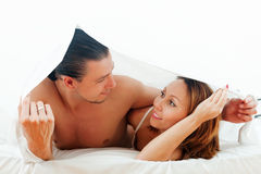 Couple  together under sheet Stock Photography