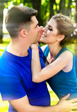 Couple together walk in park. In love guy and girl hold hands. Stock Photos
