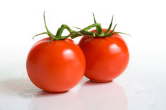 Couple tomatoes. On a white surface Royalty Free Stock Photos
