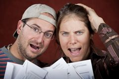 Couple with too many bills Royalty Free Stock Image