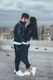 Couple on top of a building in the embrace Stock Photo